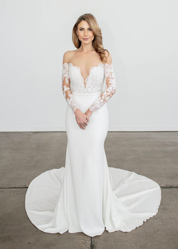 Kate - Colby John Bridal at MaidenWhite in Las Vegas. Illusion Strapless, mesh shoulder, long sleeves, lace all over detail, over Ivory crepe skirt.