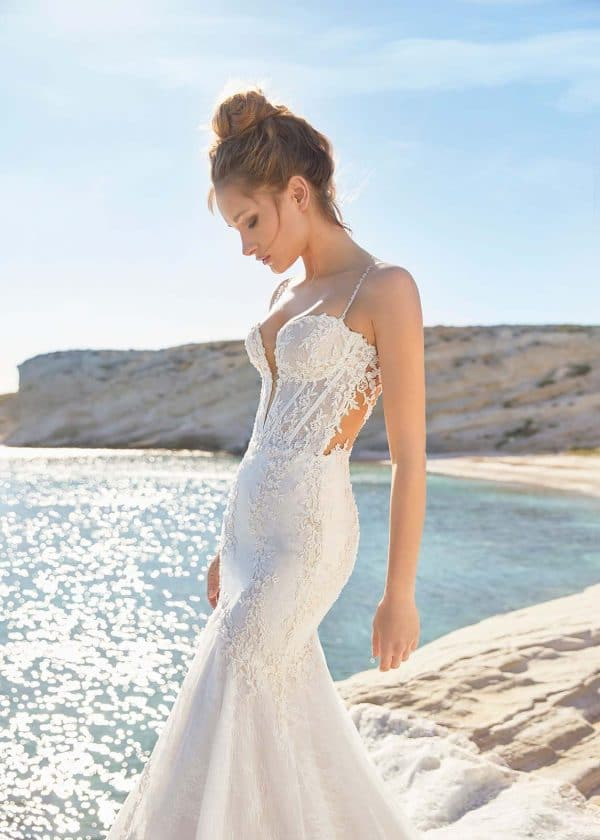 Santorini couture wedding dress lingerie beaded strap, plunging neckline, corseted bodice and lace illusion back. Mermaid silhouette with grand cathedral train.
