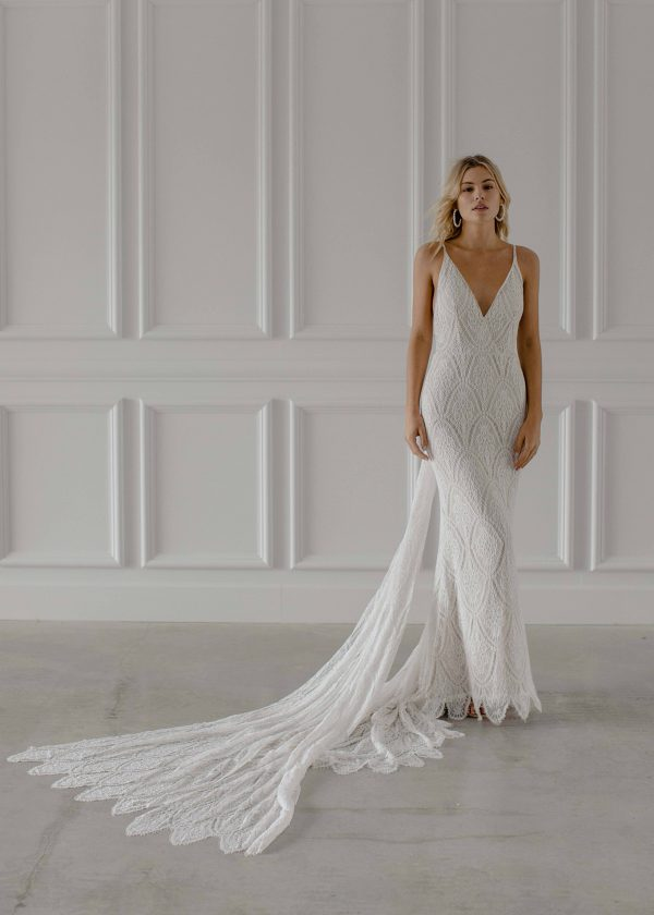 Joey - Made With Love Bridal at Maidenwhite in Las Vegas. V-neck boho bohemian spaghetti strap sheath luxury gown dress. Crochet lace bow detail at waist, cathedral train.