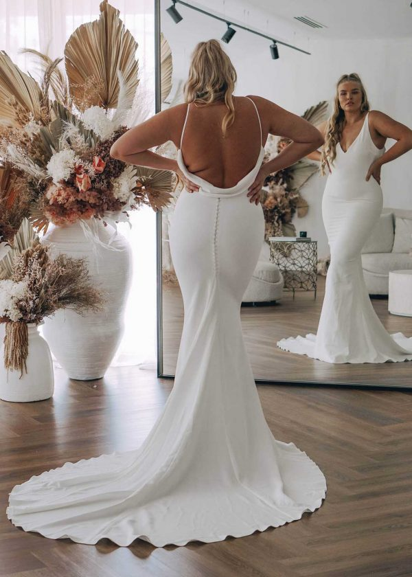 Archie - MWL Made With Love Bridal at MaidenWhite in Las Vegas. French Crepe buttery soft fit n flare trumpet sheath luxury bridal gown. Spaghetti strap, low cowl back, deep v, cathedral train. Clean, classic dress.