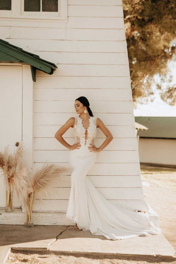 Spicy - Ines Di Santo - MaidenWhite in Las Vegas. Trumpet sheath gown deep V neck sheer illusion bodice with floral lace illusion open back tank style straps white ivory luxury bridal dress button detailing cathedral length train