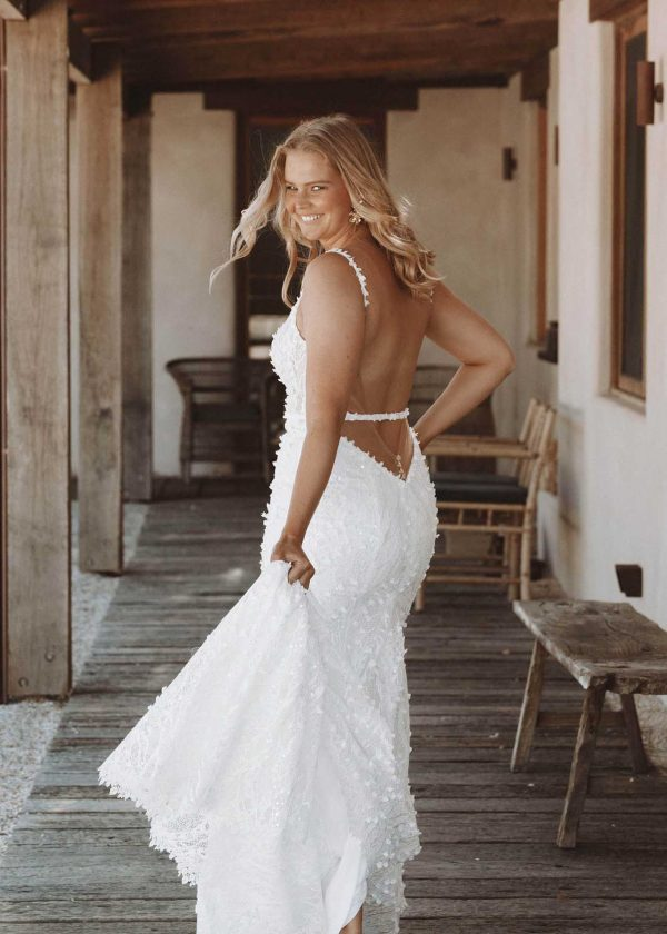 Harlow - Made With Love Bridal at MaidenWhite in Las Vegas. MWL v-back, low open back, removable belt detail, sheer lace bodice, fit n flare trumpet sheath, white ivory, spaghetti strap, scoop neck, cathedral train.