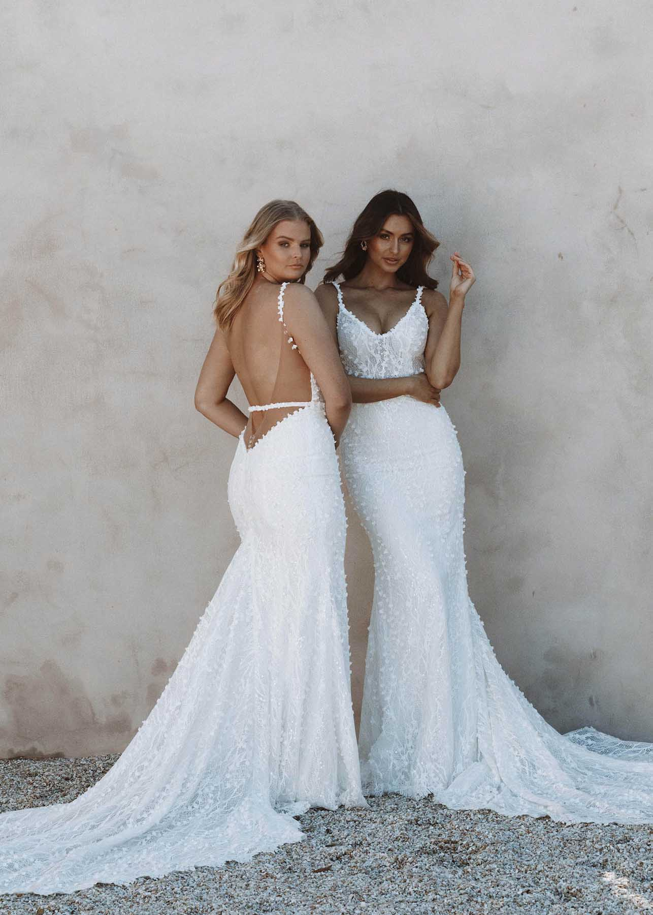 Harlow - Made With Love Bridal at MaidenWhite in Las Vegas. MWL v-back, low open back, removable belt detail, sheer lace bodice, fit n flare trumpet sheath, white ivory, spaghetti strap, scoop neck, cathedral train.q