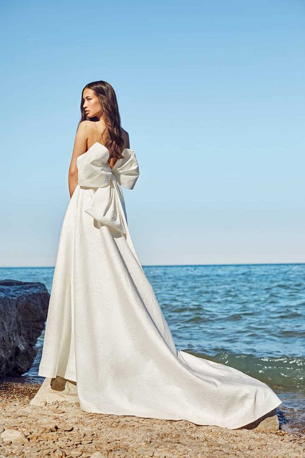 Magdalen Gown Ines Di Santo MaidenWhite couture luxury bridal Las Vegas V-neck oversized bow magnolia fabric with floral details white dress low back cathedral train