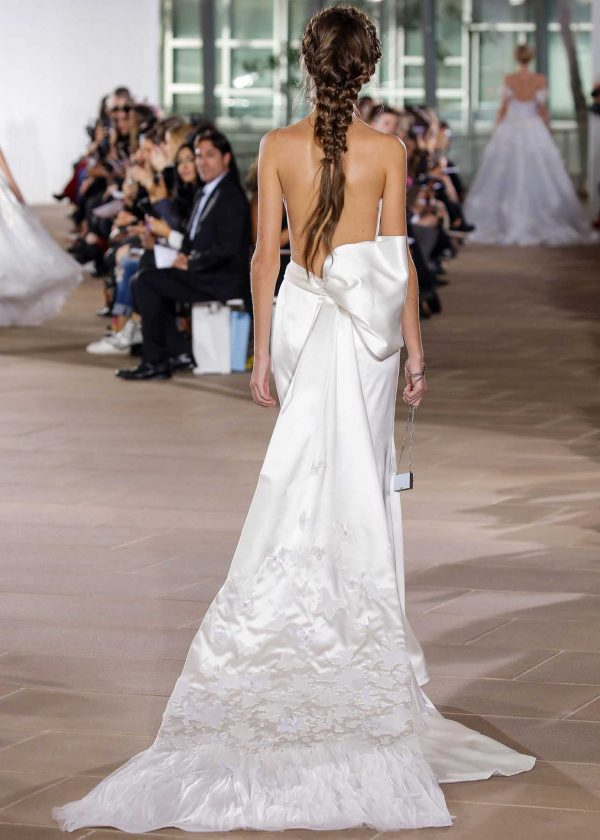 Margot - Ines Di Santo Couture at MaidenWhite in Las Vegas. Runway luxury couture bridal gown. 100% silk strapless illusion, backless sheath gown with cathedral length train. Scoop neck with thigh leg slit detail and detachable bow.