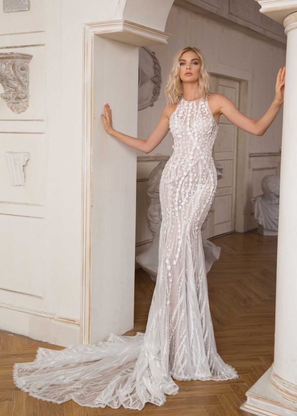 Pallas - Dany Tabet Couture at MaidenWhite in Las Vegas. Halter, sleeveless mermaid sheath trumpet fit n flare luxury bridal gown. 3D floral pieces with unique lace patterns, open back, low back. Cathedral train. Optional over skirt.