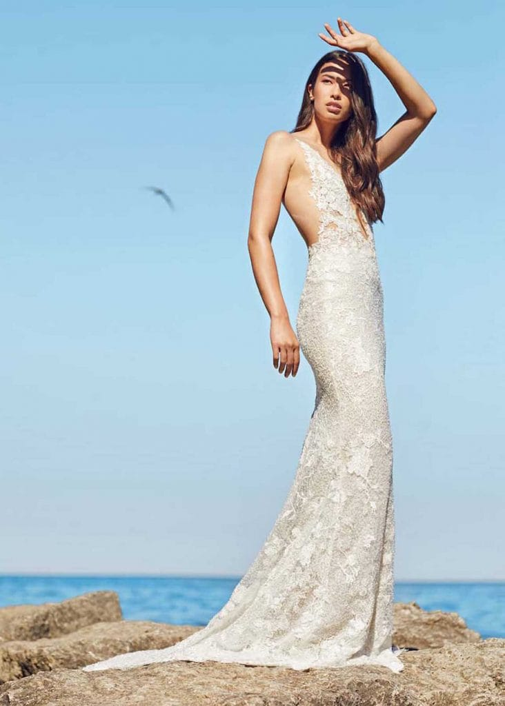 Sanibel Gown by Ines Di Santo at MaidenWhite in Las Vegas. Couture, luxury designer bridal dress with lace deep v front and open back, sheer illusion bodice with power mesh, fit n flare, mermaid gown with chapel length train