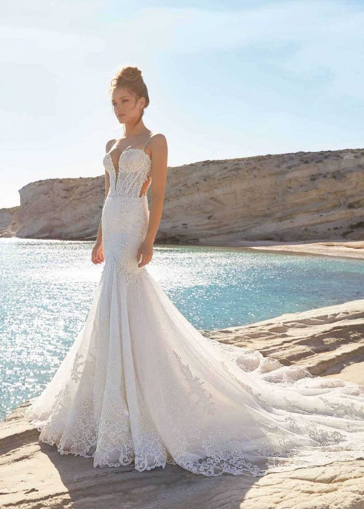 Santorini Mermaid trumpet gown by Ines Di Santo from MaidenWhite in Las Vegas. Spaghetti strap plunging neckline sheer lace illusion back corset boning structure bodice cathedral length train