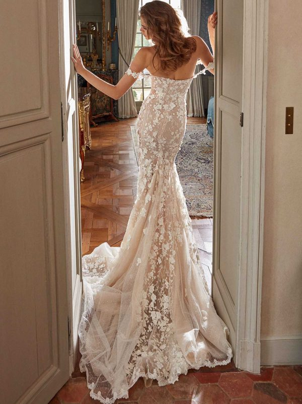 Maya - Galia Lahav couture at MaidenWhite in Las Vegas. Fit n flare mermaid sheath gown cathedral length train. Sheer silk tulle floral lace details, 3d floral appliqués, off the shoulder, nude lining.