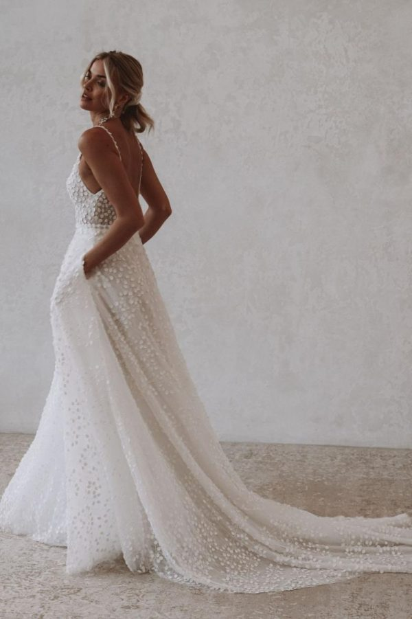 Louie Flowy - Made With Love Bridal at MaidenWhite in Las Vegas. A-line gown with 3D leaf details, spaghetti strap, plunge v-neck, v-back with pockets.